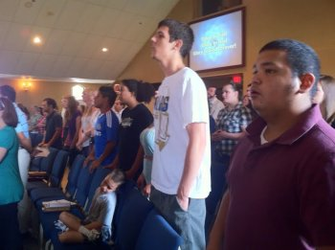 Youth standing together in worship